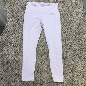 Pink yoga pants with side pockets. Never worn
